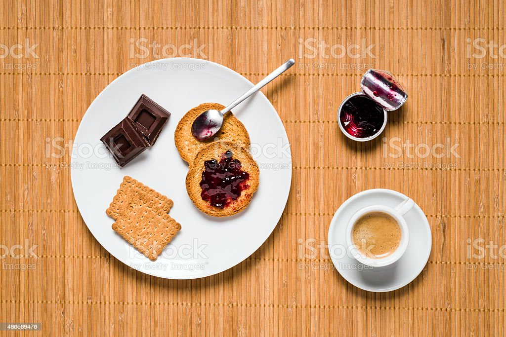 Minimalist food top view: Biscuits, chocolate and espresso coffee stock photo