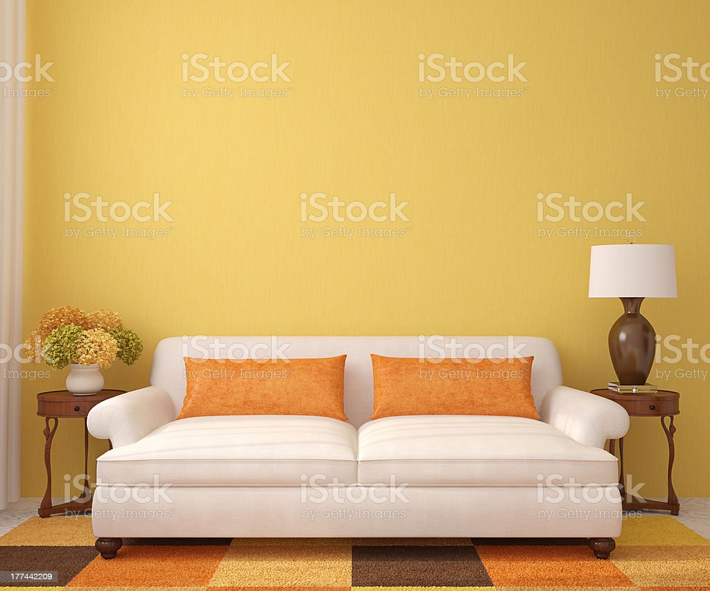 Minimalist living room, white couch and warm-colored rug stock photo