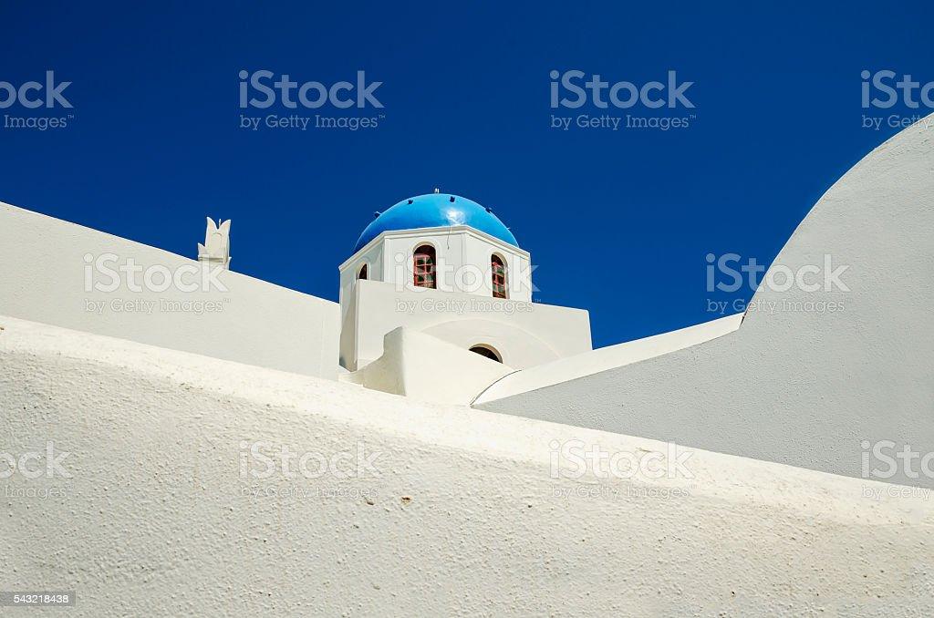 Minimalist view of white chapel with blue dome, Santorini Greece. stock photo