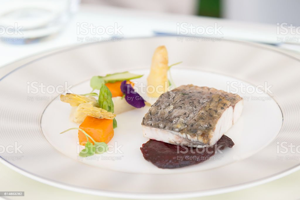 minimalistic dish fish with vegetables stock photo