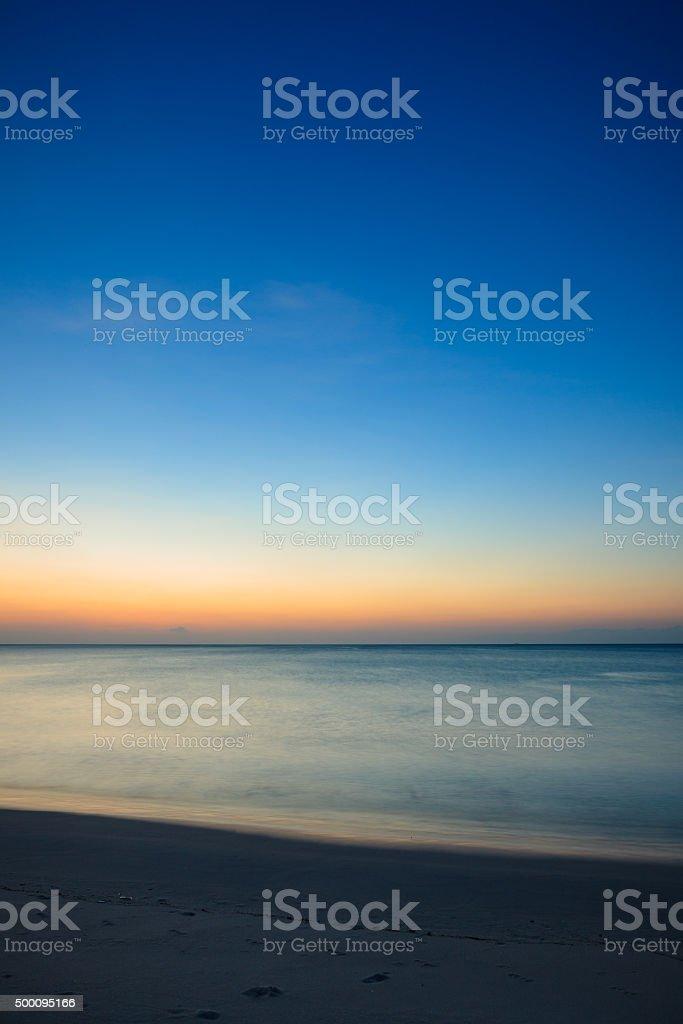 Minimalistic seascape at twilight stock photo