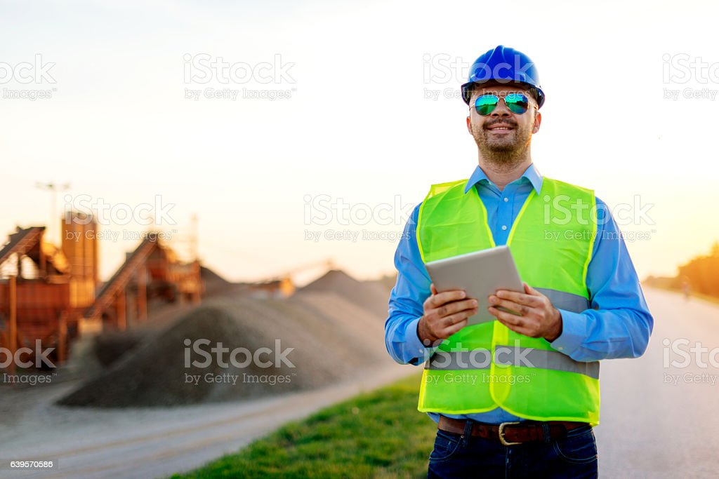 Mining industry and manager near the mine pit stock photo