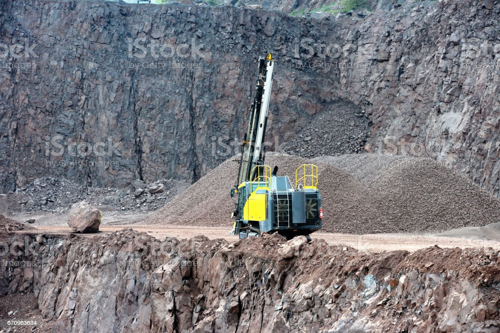 mining industry. Drill equipment in a open pit mine. stock photo