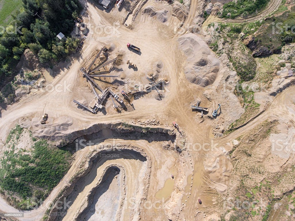 Mining quarry with special equipment, open pit excavation. stock photo