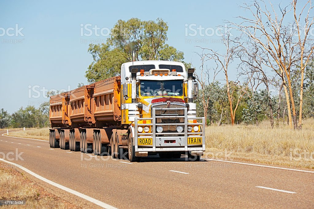 Mining road train on sealed road in outback Australia stock photo
