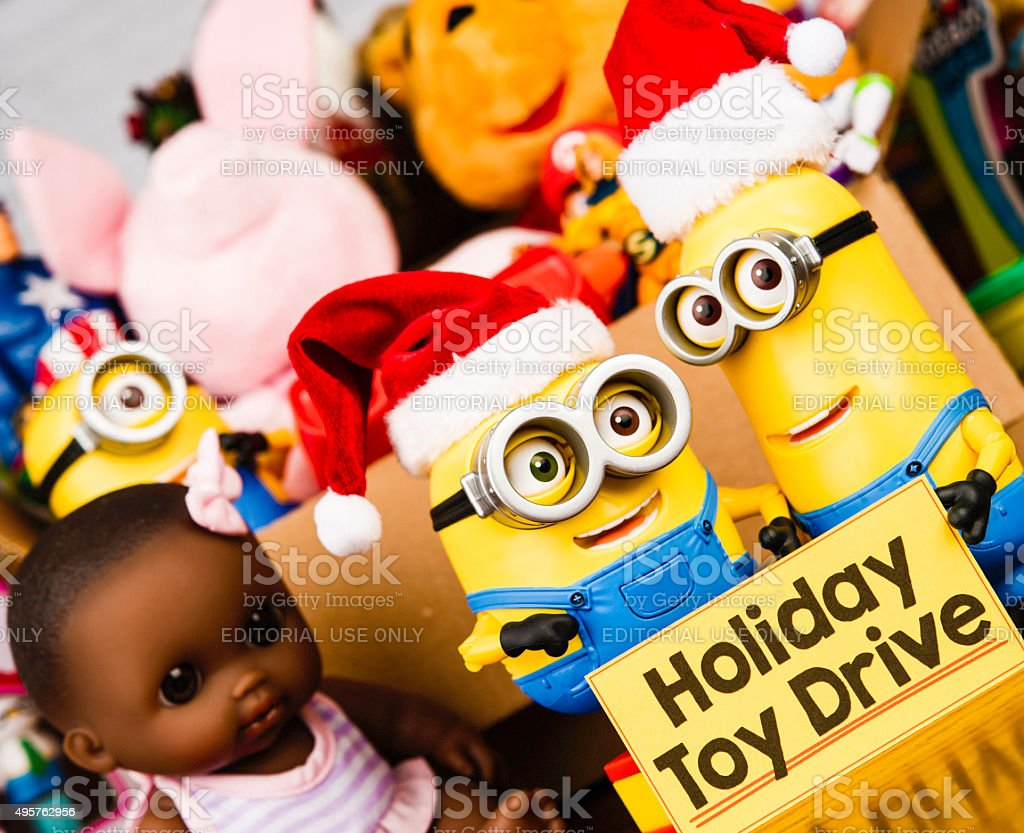 Minion Bob and Kevin promoting a toy drive stock photo