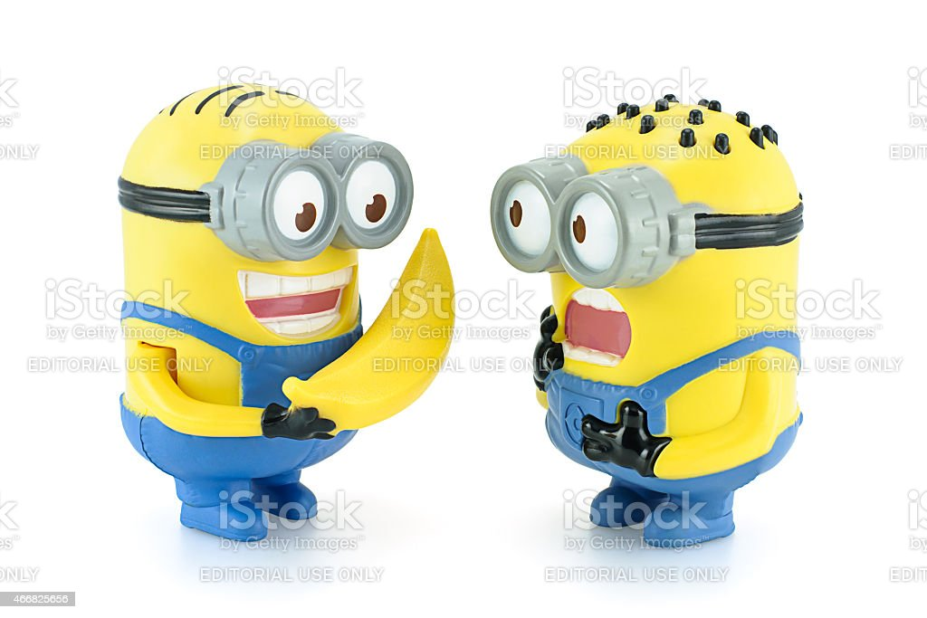 Minion Dave give banana to Minion. stock photo