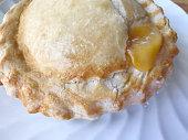Mini-sized peach pie with cinnamon