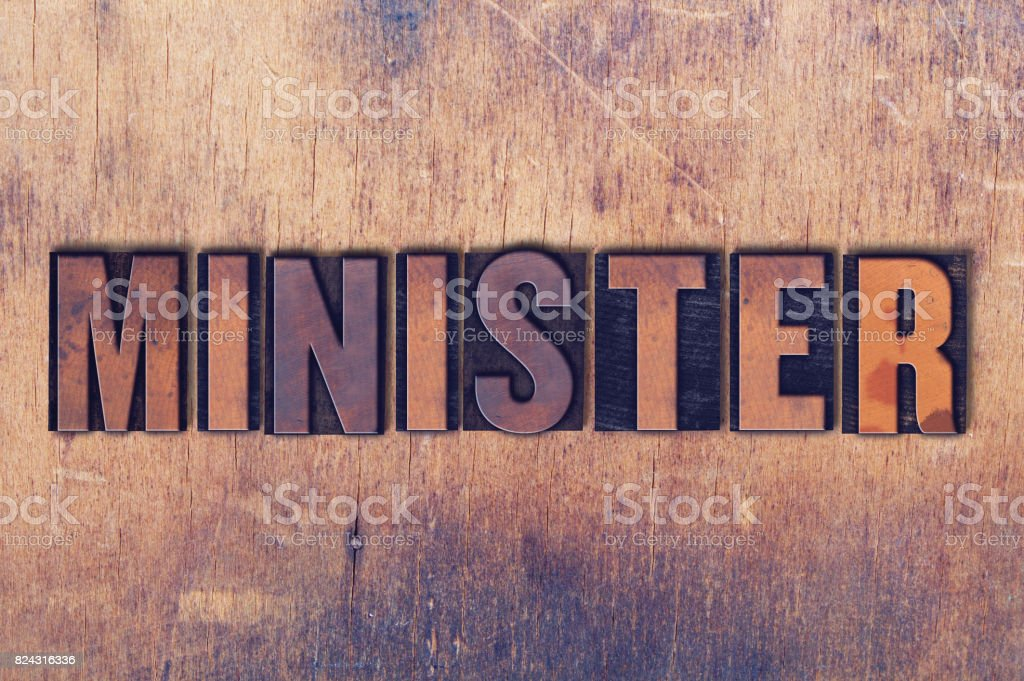 Minister Theme Letterpress Word on Wood Background stock photo