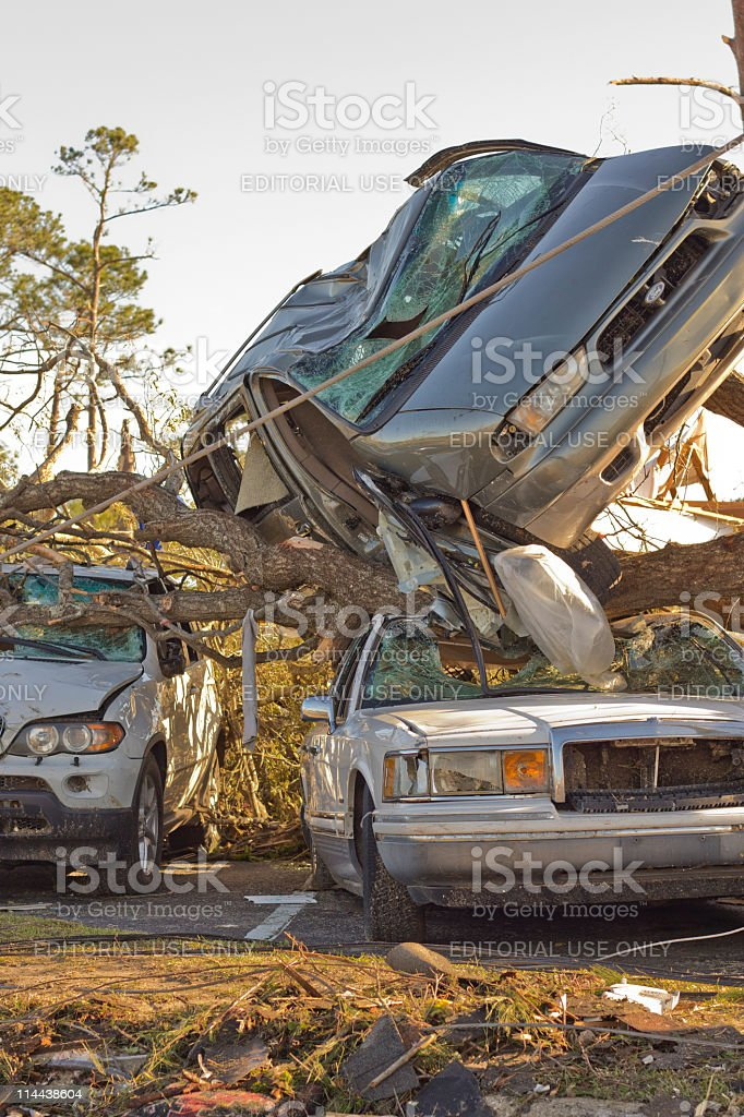 Minivan thrown onto a Cadillac by tornado royalty-free stock photo