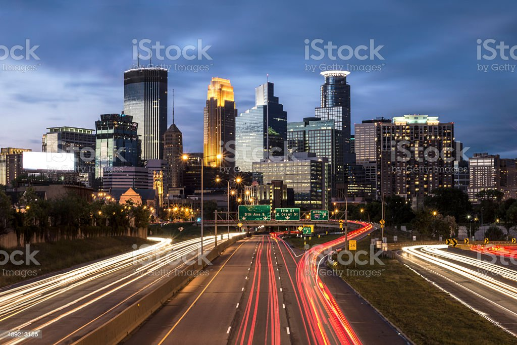 Minneapolis City Skyline at Night and Traffic Light Tails stock photo