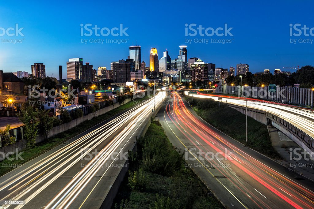 Minneapolis City Skyline with Car Light Trails at Dusk stock photo