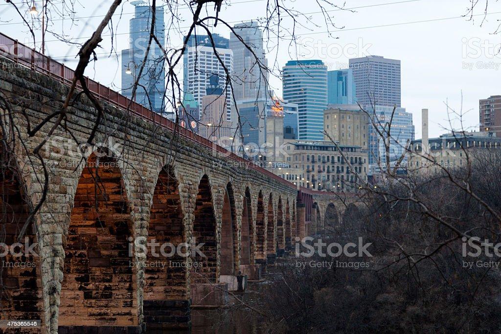 Minneapolis Minnesota skyline with Stone Arch bridge stock photo