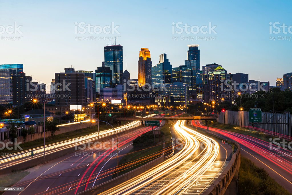 Minneapolis Skyline and Traffic Light Trails at Sunset stock photo