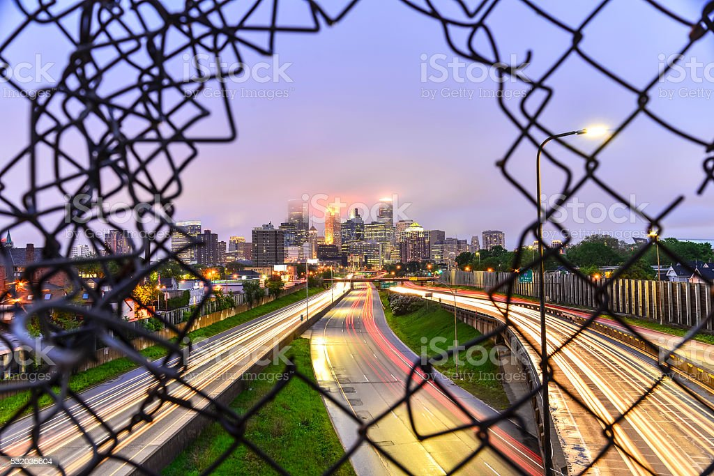 Minneapolis Skyline through the Wire and Traffic stock photo