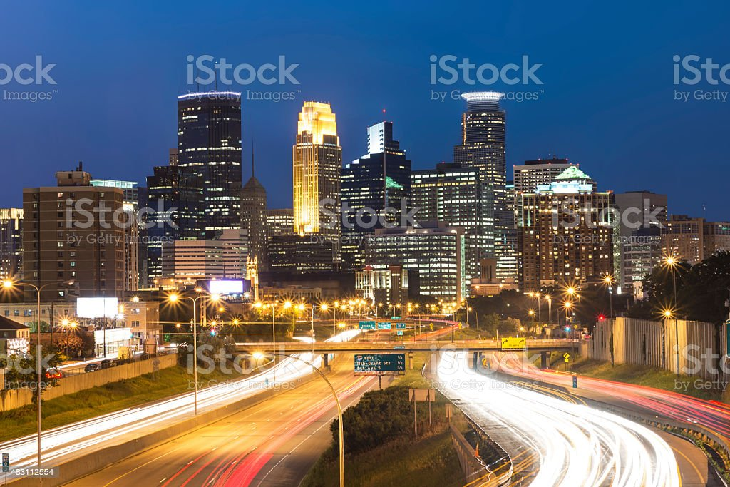 Minneapolis Skyline with Car Light Trails at Night stock photo