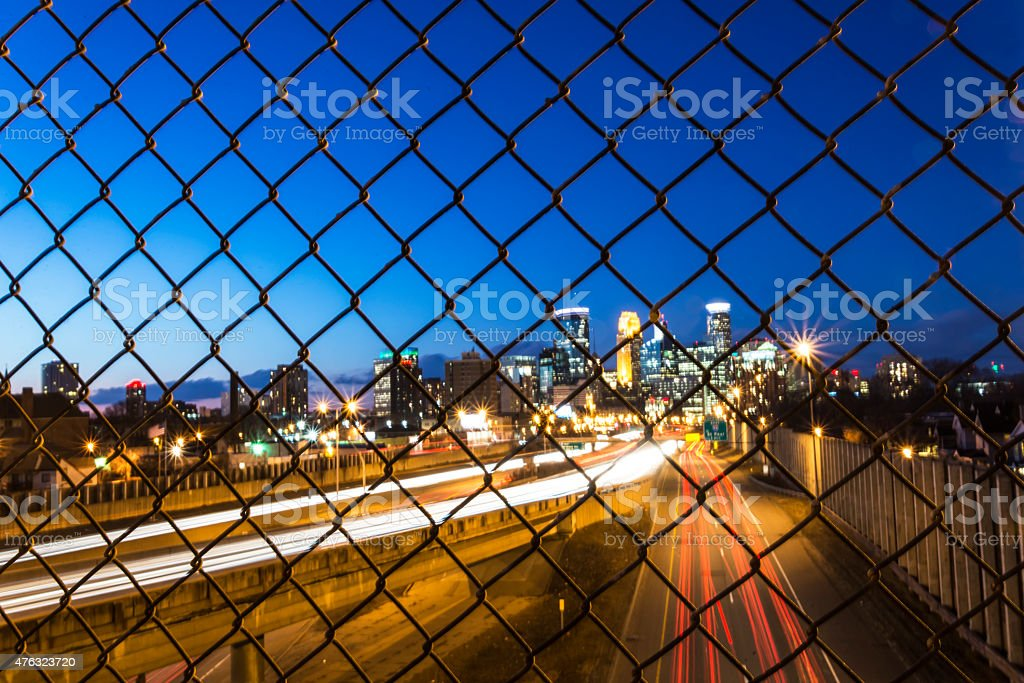 Minneapolis Skyline with Light Trails Through Fence stock photo