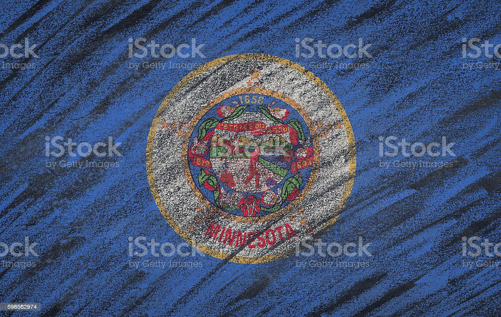 Minnesota flag painted with colored chalk on a blackboard. stock photo