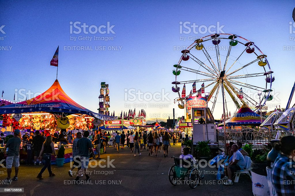 Minnesota State Fair's Busy Midway Area at Dusk stock photo