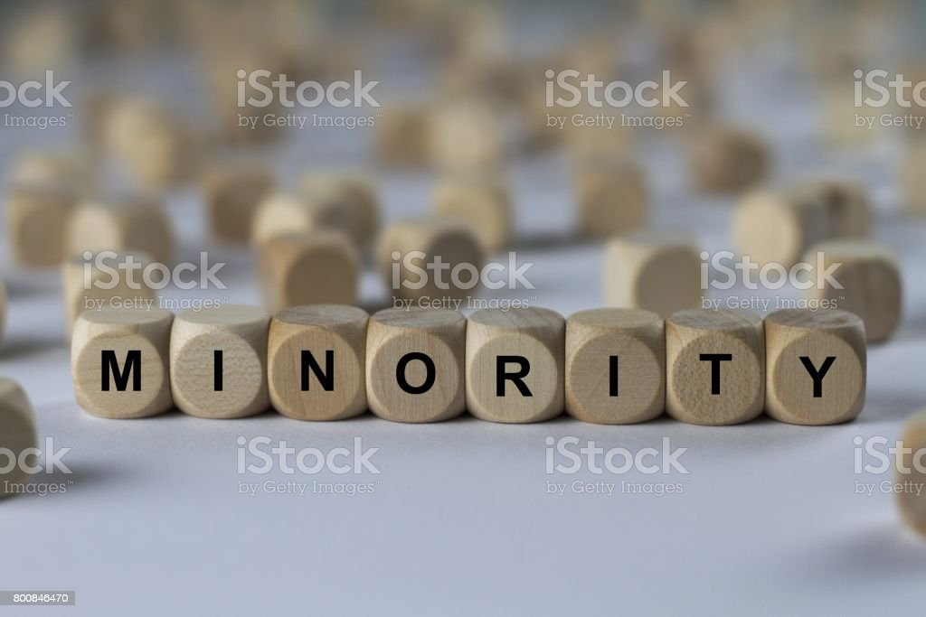 minority - cube with letters, sign with wooden cubes stock photo
