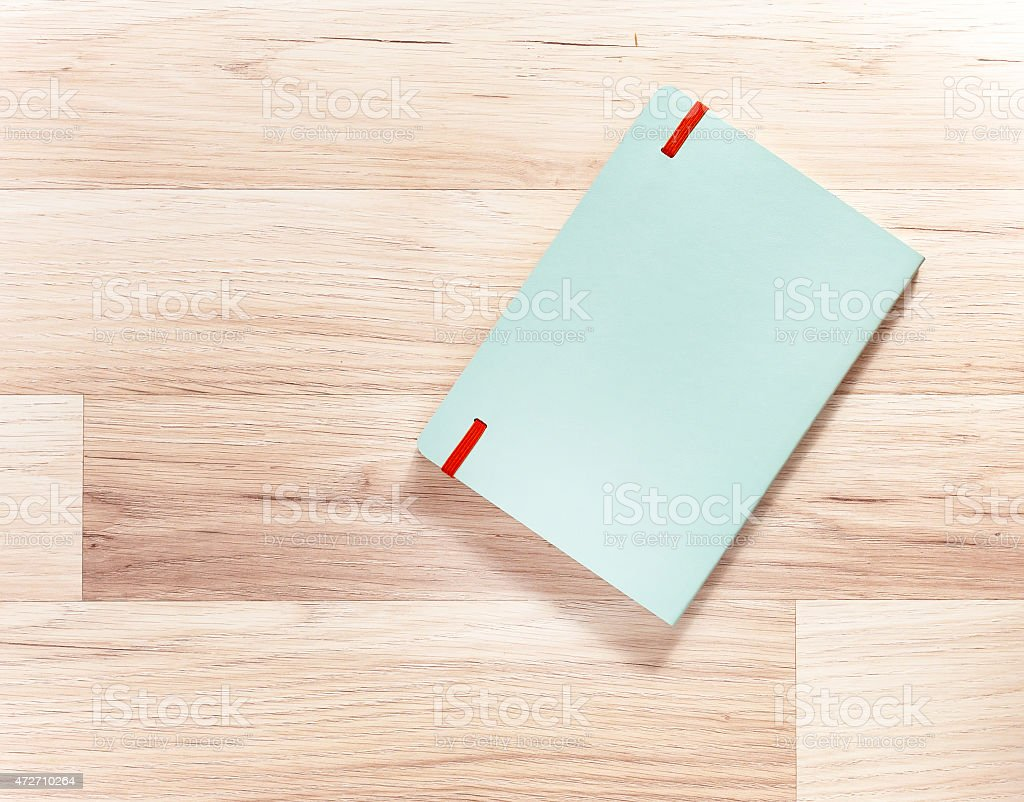 mint leather cover note book on wooden background with shadow stock photo