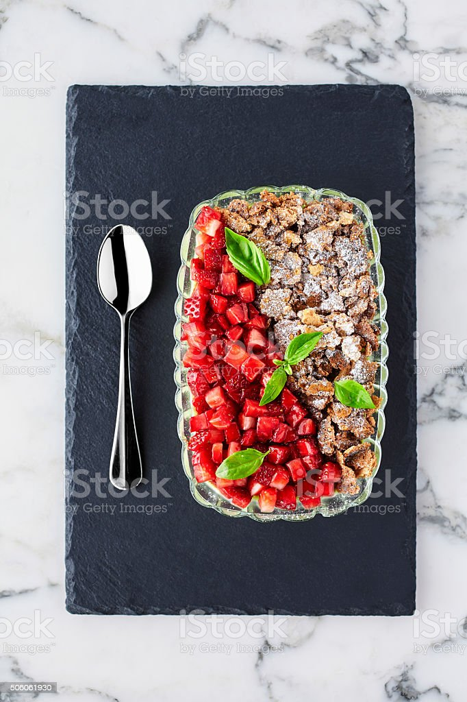Mint pudding with strawberry and biscuit crumbs stock photo