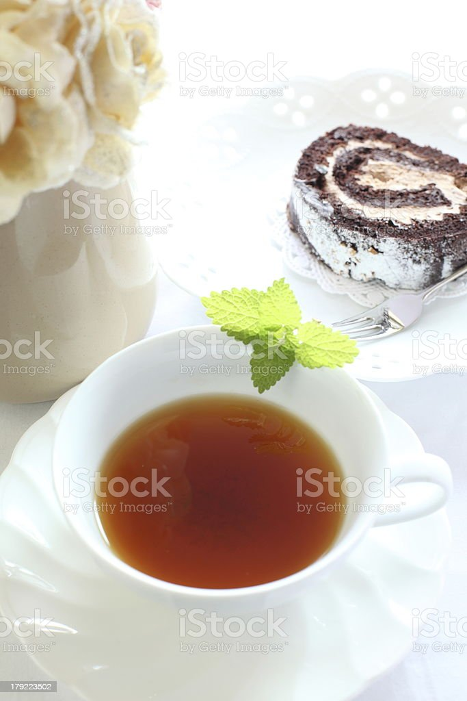 Mint tea and chocolate swiss roll royalty-free stock photo