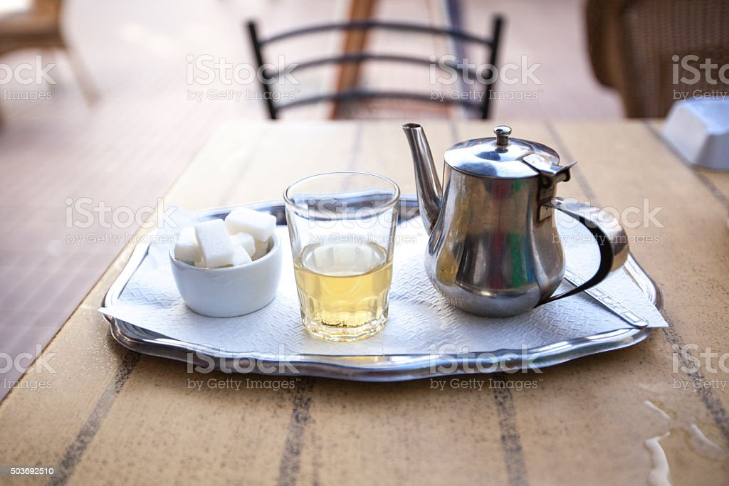 Mint Tea and sugar on silver platter stock photo