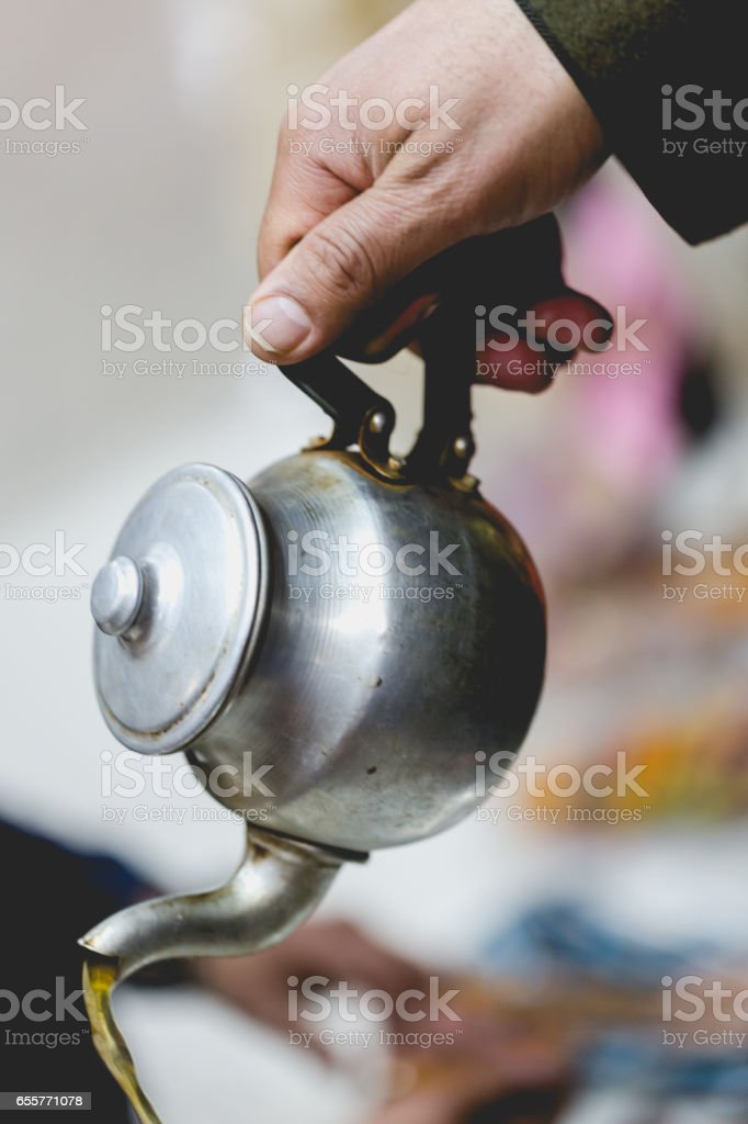 Mint tea in traditional tin pot for guests stock photo