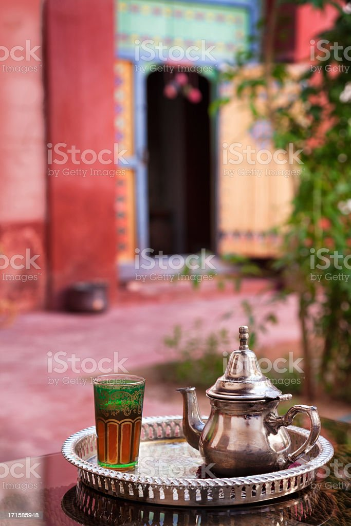 Mint tea served in Moroccan Riad (courtyard) stock photo