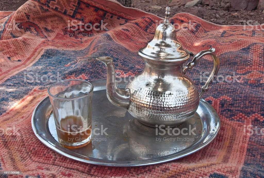 Mint tea served on a silver platter stock photo
