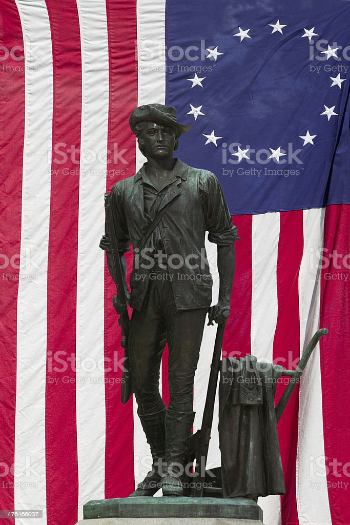 Minuteman Statue and US Flag stock photo