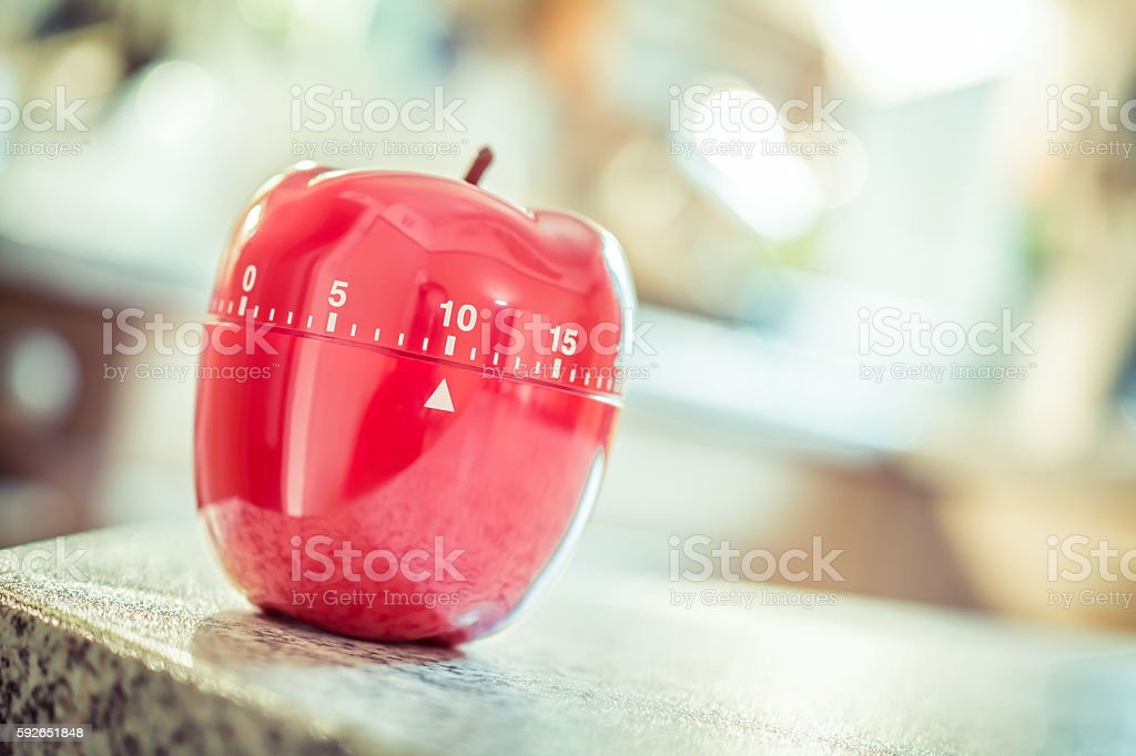 10 Minutes - Red Kitchen Egg Timer In Apple Shape stock photo