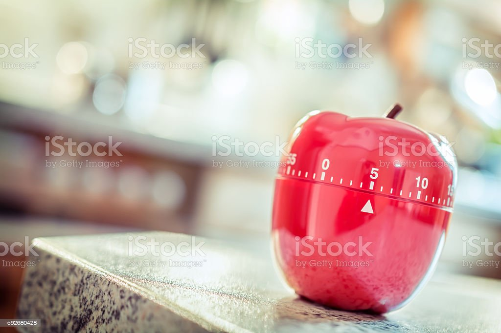 5 Minutes - Red Kitchen Egg Timer In Apple Shape stock photo