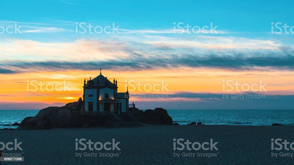 Miramar Beach and Chapel Senhor da Pedra at night, Portugal. stock photo