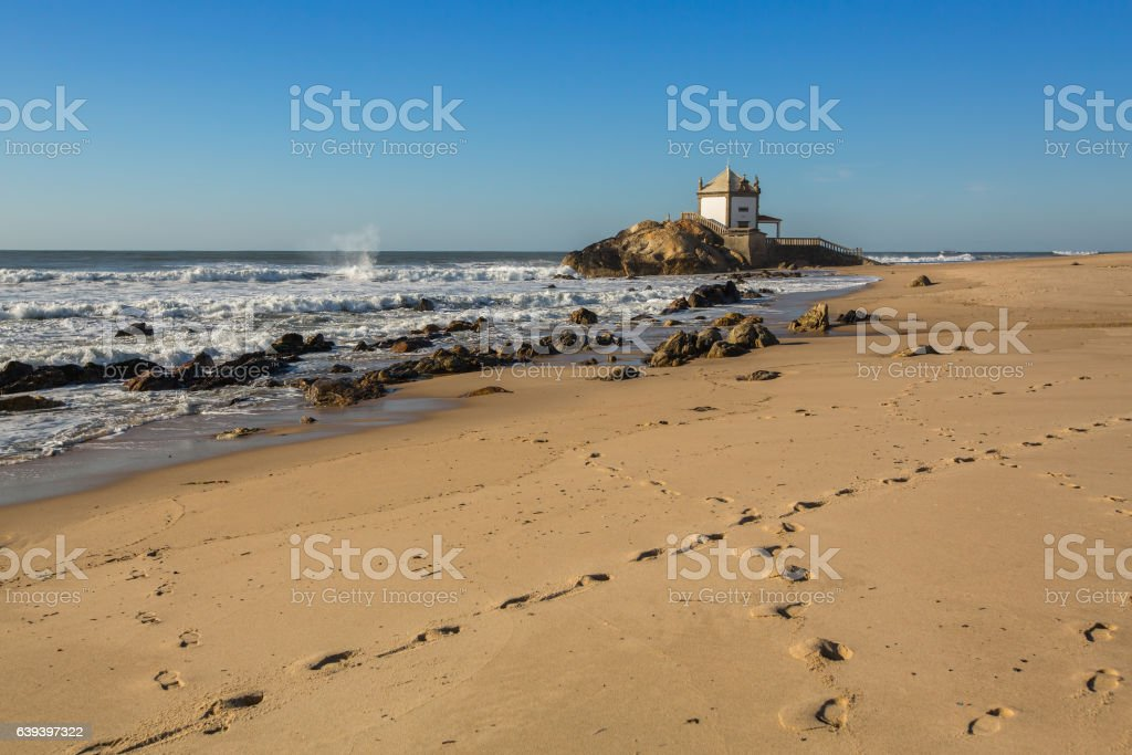 Miramar Beach (Praia de Miramar) and chapel Senhor da Pedra stock photo