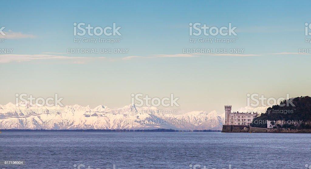 Miramar Castle with Italian Alps in background. stock photo
