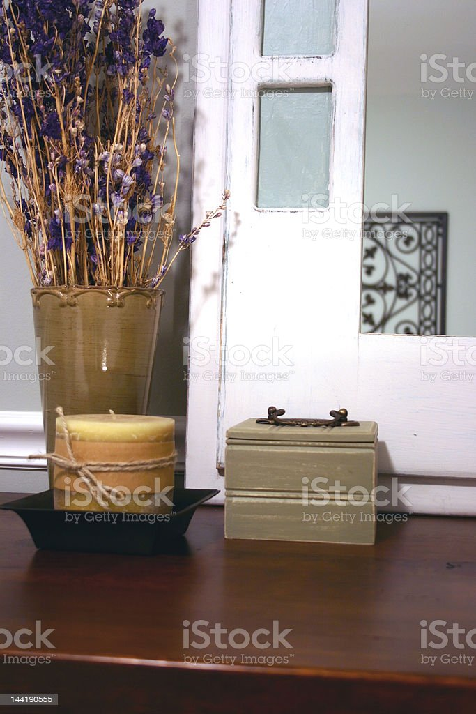 Mirror, candle, vase, and box on dresser. royalty-free stock photo