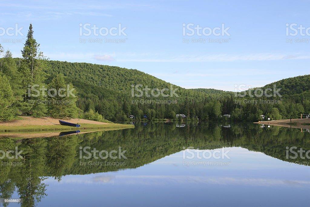 Mirror effect on a lake stock photo