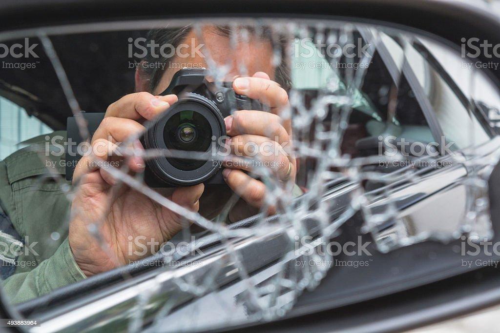 Mirror image, a photographer in the broken mirror stock photo