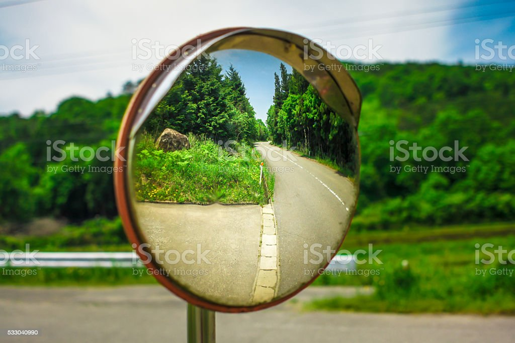Mirror in cross street for improving visibility stock photo