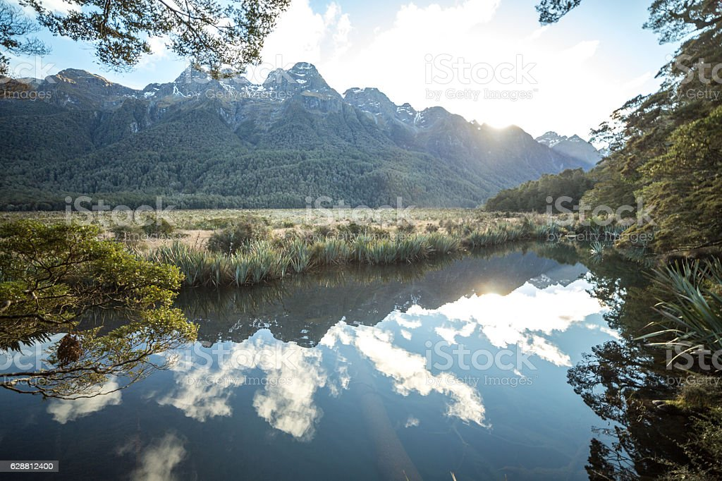 Mirror lake and its reflection, New Zealand stock photo