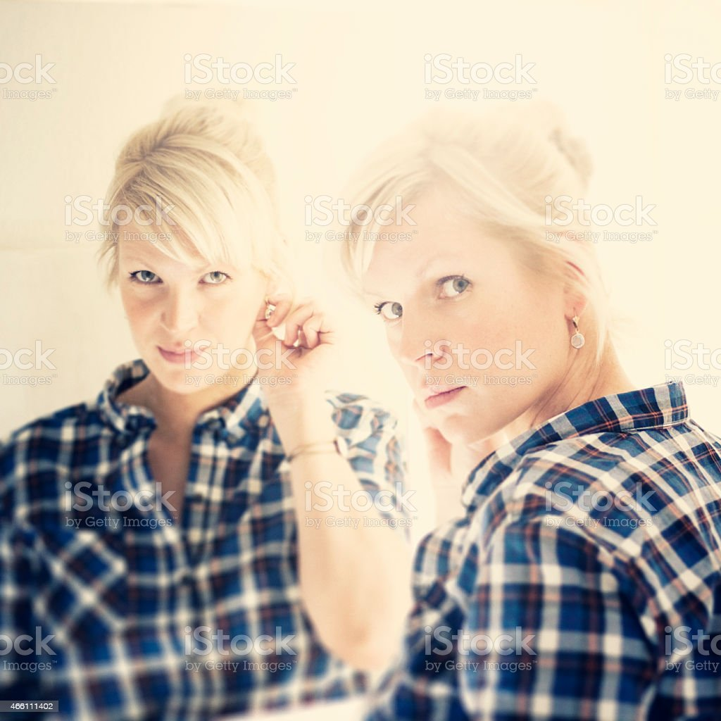 Mirror mirror on the wall......blond woman and her reflection stock photo