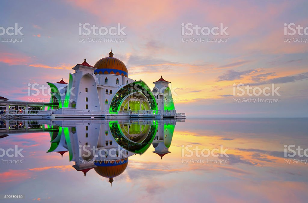 mirror reflection of majestic floating mosque at malacca straits stock photo
