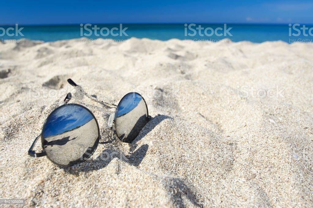 Mirror sunglasses on beach stock photo