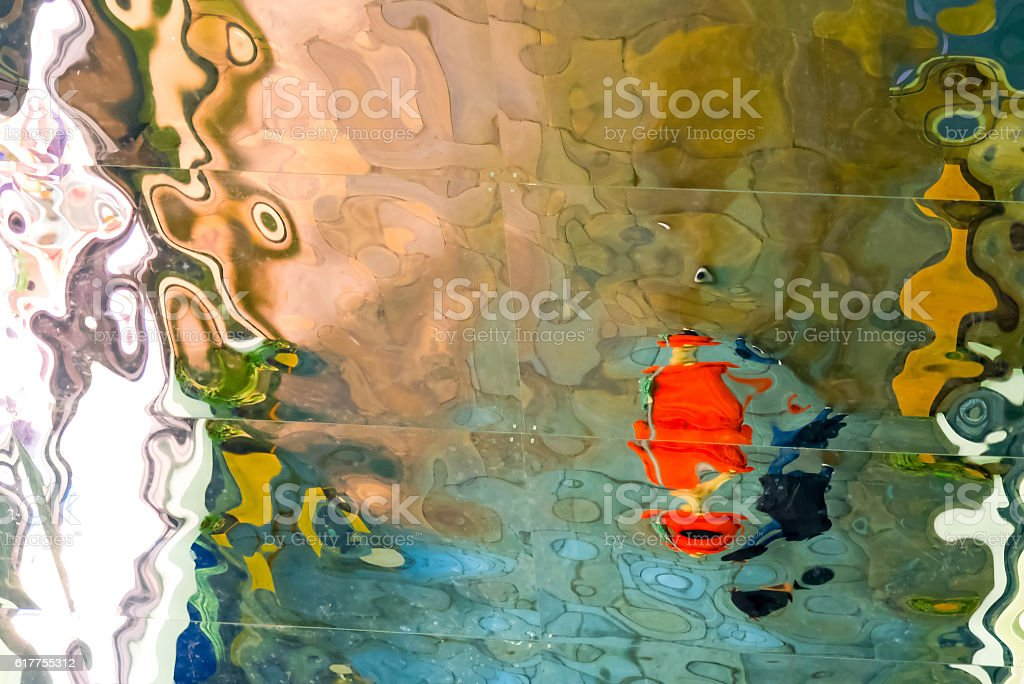 Mirror tiles distorting the image producing an abstract pattern stock photo