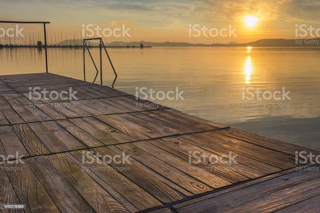 Mirror water at sunset in Balaton stock photo