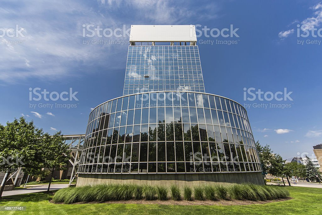 mirrored building against blue sky stock photo