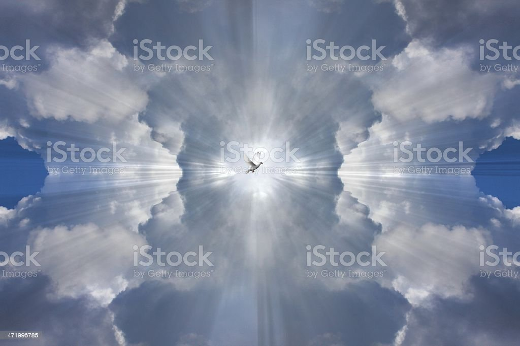 Mirrored clouds and light rays representing the Holy spirit stock photo