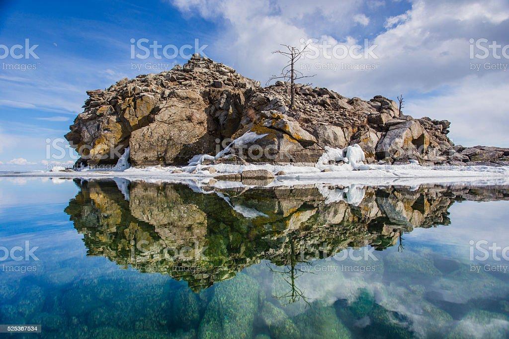 Mirroring island in water at Lake Baikal stock photo